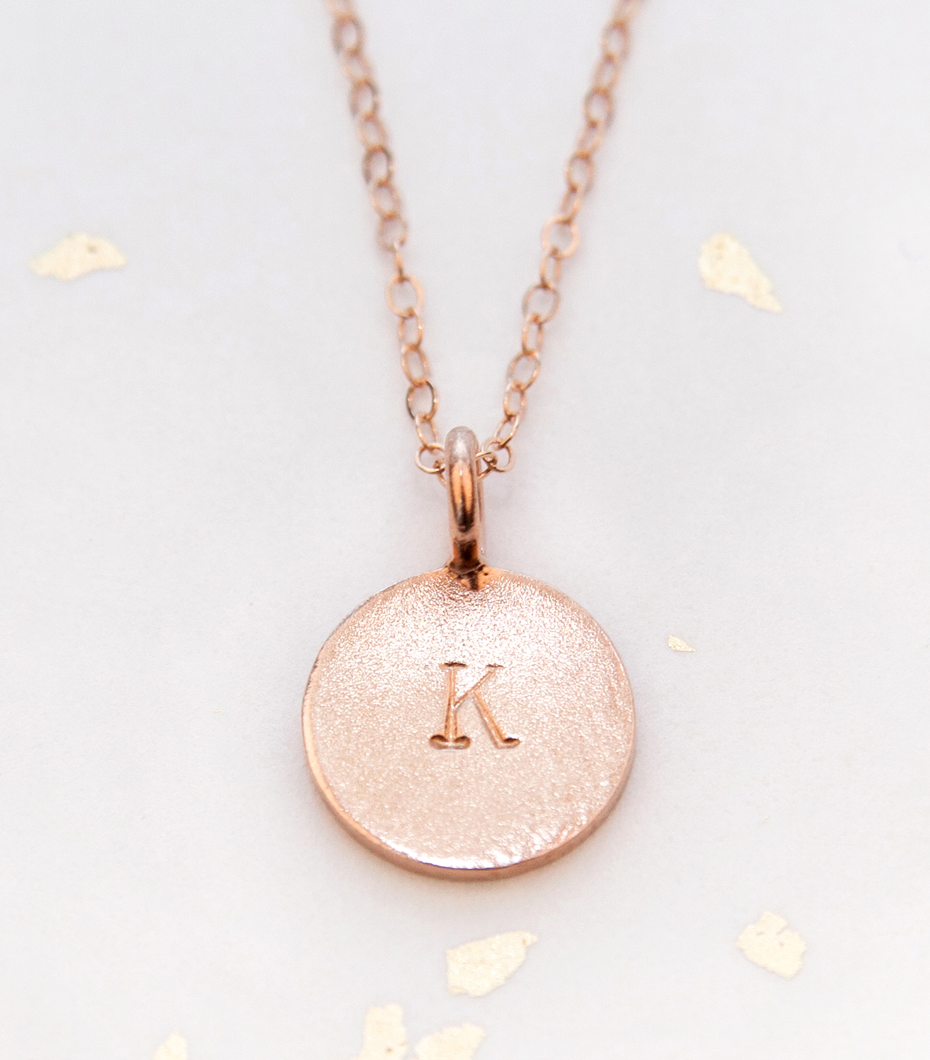 Add a wire-wrapped birthstone and charm to this hand stamped initial necklace to create a unique gift for each bridesmaid.